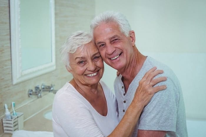 image of happy seniors in the bathroom